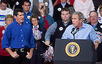 President George W. Bush speaks at a campaign rally for republican Montana Senator Conrad Burns while congressman Denny Rehberg listens at MetraPark in Billings, Mont., Nov. 2, 2006.