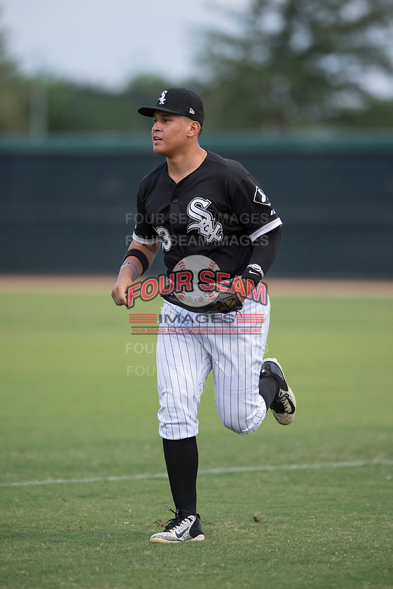 AZL White Sox right fielder Anthony Coronado (13) jogs off the field between innings of an Arizona League game against the AZL Athletics at Camelback Ranch on July 15, 2018 in Glendale, Arizona. The AZL White Sox defeated the AZL Athletics 2-1. (Zachary Lucy/Four Seam Images)