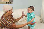 7 month old baby boy with grandmother playful interaction