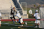 San Diego, CA 05/29/10 - Nick Graige (Torrey Pines # 21), Reid Tudor (LCC# 24) and Eric Sanschagrin (LCC# 18) in action during the La Costa Canyon vs Torrey Pines boys lacrosse game for the 2010 San Diego Section CIF Championship, hosted at Del Norte High School.  La Costa Canyon defeated Torrey Pines 12-6.