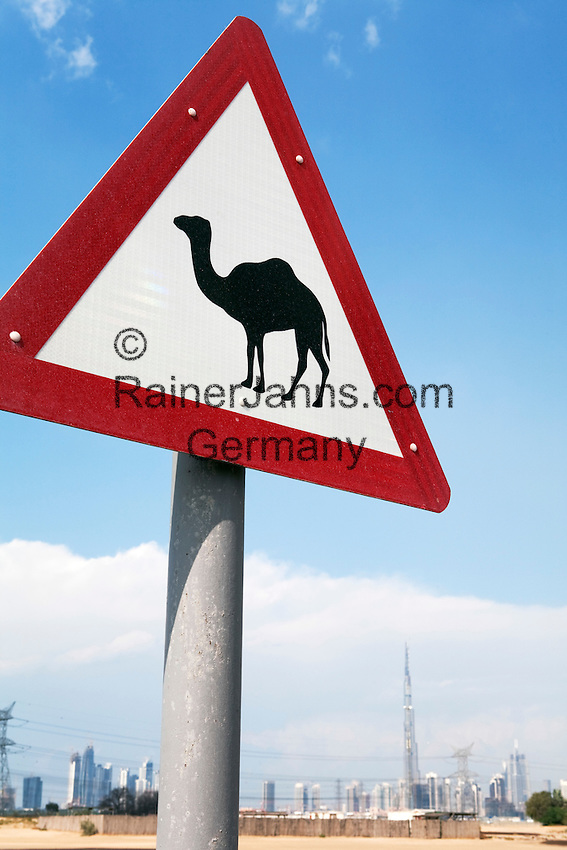 United Arab Emirates, Dubai: Camel crossing road sign and Dubai city skyline