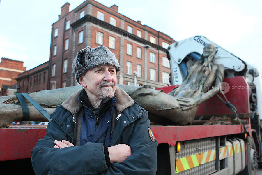16/12/2010. Sculptor Eamon O Doherty is pictured with his work the Anna Livia (Floozie in the Jacuzzi) on a truck in O'Connell Street Dublin before she goes to her  new home in the park opposite the Aisling Hotel Dublin.James Horan/Collins Photos
