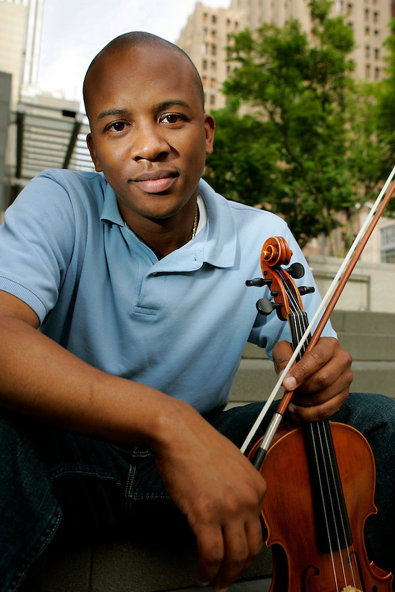 SEATTLE, WA--Quinton Morris plays violin for The Young Eight among other things the violinist is actively involved. Photo by Kevin P. Casey