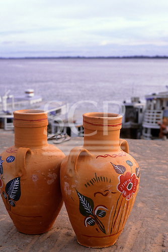 Santarem, Brazil. Hand-painted unglazed decorated pots for sale at the harbour.