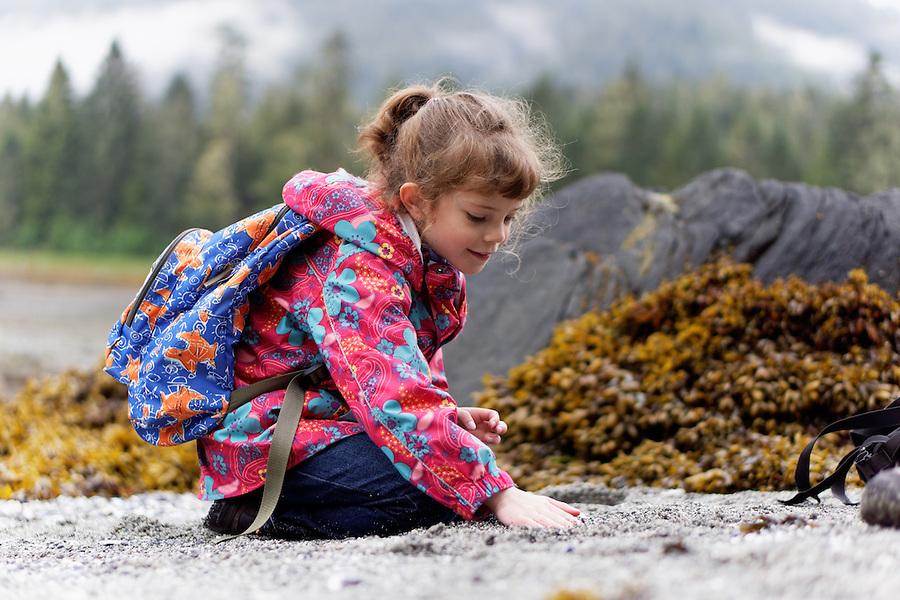 Girl playing on beach, Sandy Beach Recreation Area, Petersburg, Alaska