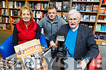 Maureen O'Shea and Peter Nammock with John Cleary at his book signing at O'Mahonys Bookshop in Tralee on Saturday.