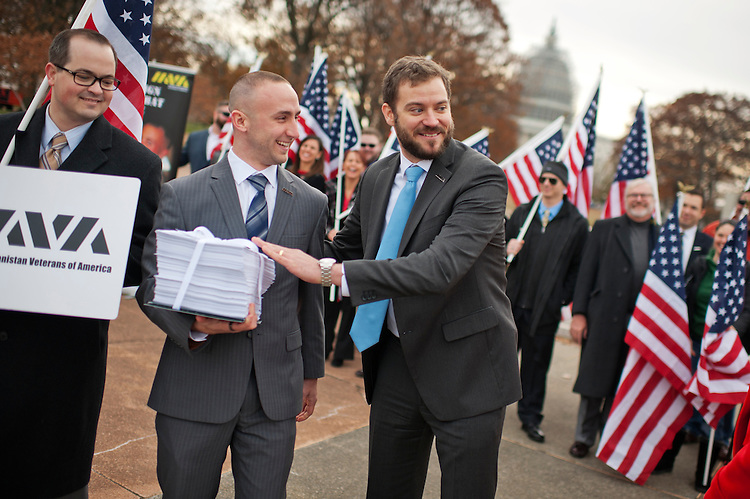 UNITED STATES - DECEMBER 04: Bill Rausch, right, political director for the Iraq and Afghanistan Veterans of America, and Kris Goldsmith, an Iraq war vet, conduct a rally in Upper Senate Park, December 4, 2014. The group held a rally before delivering over 58,000 petitions, held by Goldsmith, to Senate Majority Harry Reid, D-Nev., urging him to bring the Clay Hunt Suicide Prevention Bill to the floor. (Photo By Tom Williams/CQ Roll Call)