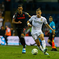 Leeds United's Kalvin Phillips takes on Stoke City's Thomas Ince<br /> <br /> Photographer Alex Dodd/CameraSport<br /> <br /> The Carabao Cup Second Round- Leeds United v Stoke City - Tuesday 27th August 2019  - Elland Road - Leeds<br />  <br /> World Copyright © 2019 CameraSport. All rights reserved. 43 Linden Ave. Countesthorpe. Leicester. England. LE8 5PG - Tel: +44 (0) 116 277 4147 - admin@camerasport.com - www.camerasport.com