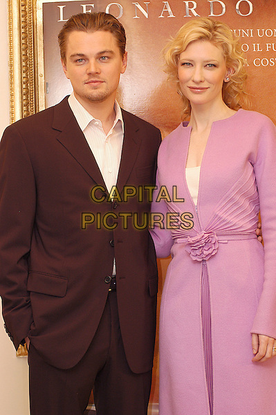 "LEONARDO DiCAPRIO & CATE BLANCHETT.Photocall for ""The Aviator"".Hotel Hassler, Rome, Italy, January 4th 2004.                      .half length pink dress coat jacket zip flower belt kate blanchet Di Caprio.Ref: LC.www.capitalpictures.com.sales@capitalpictures.com.©Luca Cavallari/Capital Pictures ."