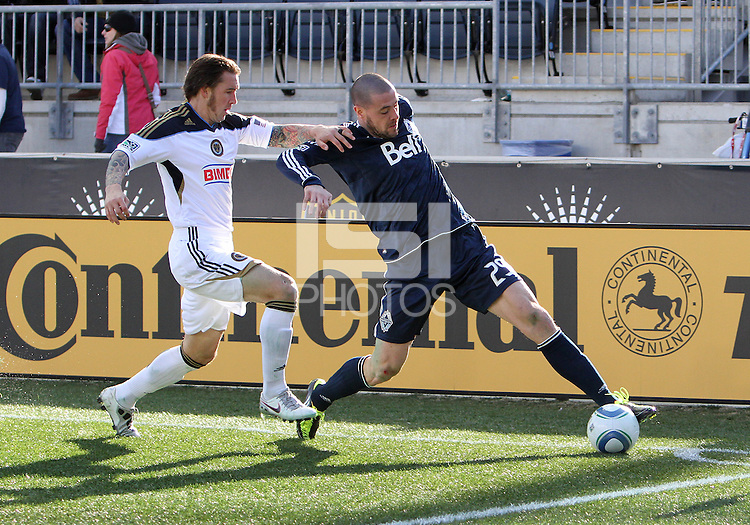 Danny Califf#4 of the Philadelphia Union holds up Eric Hassli#29 of the Vancouver Whitecaps during an MLS match at PPL Park in Chester, PA. on March 26 2011. Union won 1-0.