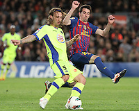 10.04.2012 Bacelona, Spain. La Liga. Picture show Alexis (L) and Isaac Cuenca in action during match between FC Barcelona against Getafe at Camp Nou