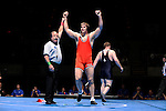 12 MAR 2011: John Helgerson of Wartburg celebrates his victory over Mark Corsello of Elmhurst during the Division III Men's Wrestling Championship held at the La Crosse Center in La Crosse Wisconsin. Helgerson defeated Corsello 3-1 to claim the national title. Stephen Nowland/NCAA Photos