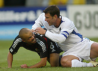 3 April 2004: DC United Earnie Stewart and Earthquakes Jeff Agoos laugh each other after colliding into each other during the second half of the game at RFK Stadium in Washington D.C..  Credit: Michael Pimentel / ISI
