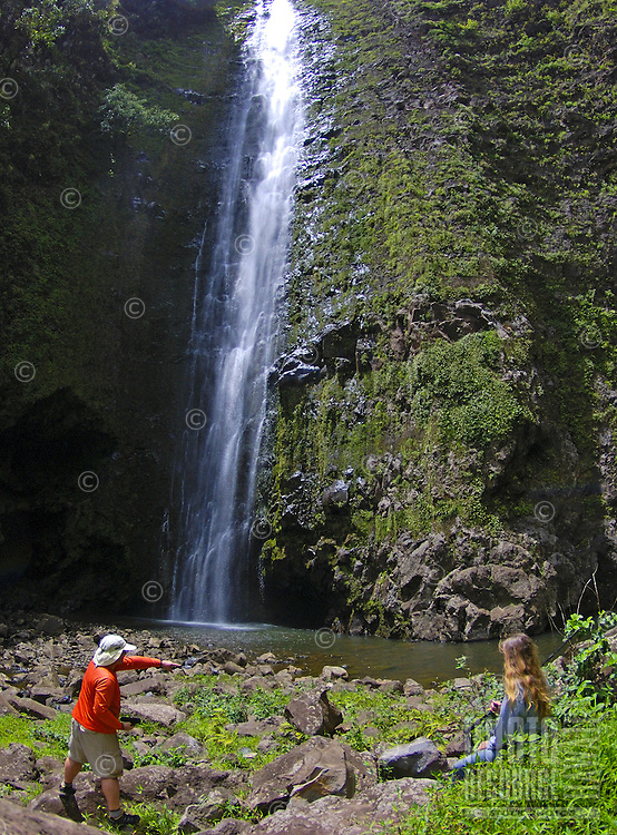 Hikers survey Halawa Falls (left fork), Molokai