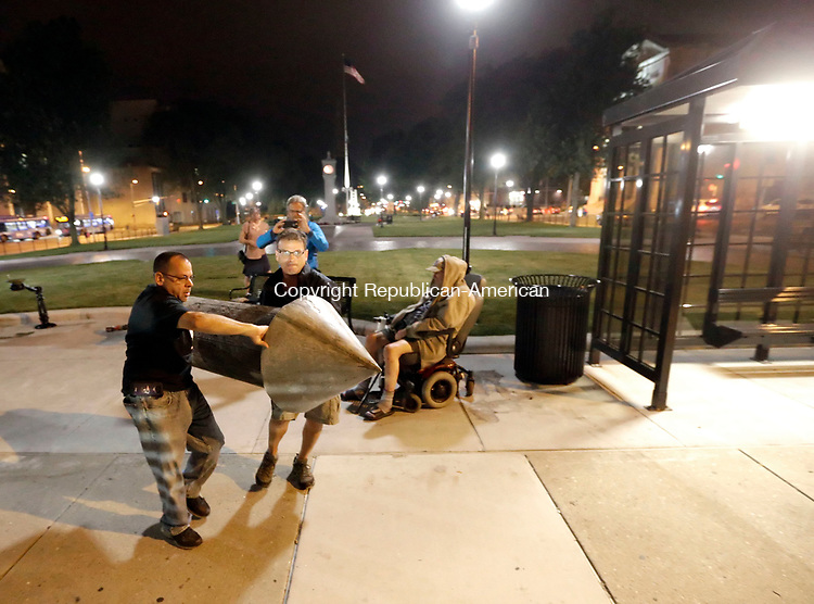 Waterbury, CT- 27 July 2017-072717CM05-   Waterbury Department of Public Works employees remove a post on the City green on Thursday night.  The post which has caused controversy in recent time was removed and taken away from the green.        Christopher Massa Republican-American
