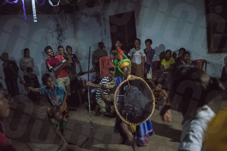 "March 24, 2016 - Wainyapu (Indonesia). John (center) performs a traditional dancing during the mass hold the night before Good Friday in the small church of the village. John is a veteran of many Pasola. He started when he was just 15 and he's now riding the ""Halato"", one of the two horses that are used to open the festival. © Thomas Cristofoletti / Ruom"
