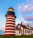 Lubec, Maine: West Quoddy Head Light at dawn with pink clouds and moonset.