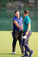 Patrick Reed (USA) and Justin Rose (ENG) on the 18th green during the 3rd round at the WGC HSBC Champions 2018, Sheshan Golf CLub, Shanghai, China. 27/10/2018.<br /> Picture Fran Caffrey / Golffile.ie<br /> <br /> All photo usage must carry mandatory copyright credit (&copy; Golffile | Fran Caffrey)