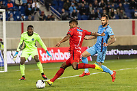 HARRISON, NJ - FEBRUARY 26: Jorman Aguilar #7 of AD San Carlos takes a shot as Sean Johnson #1 and Maxime Chanot #4 of NYCFC defend during a game between AD San Carlos and NYCFC at Red Bull on February 26, 2020 in Harrison, New Jersey.
