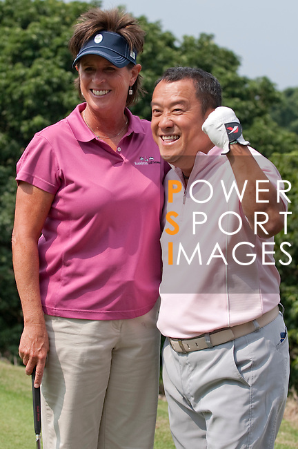 HAIKOU, CHINA - OCTOBER 29:  Solheim Cup's captain Rosie Jones (L) of the USA and Hong Kong actor Eric Tsang pose for a photograp on the 8th tee during day three of the Mission Hills Start Trophy tournament at Mission Hills Resort on October 29, 2010 in Haikou, China. The Mission Hills Star Trophy is Asia's leading leisure liflestyle event which features Hollywood celebrities and international golf stars. Photo by Victor Fraile / The Power of Sport Images