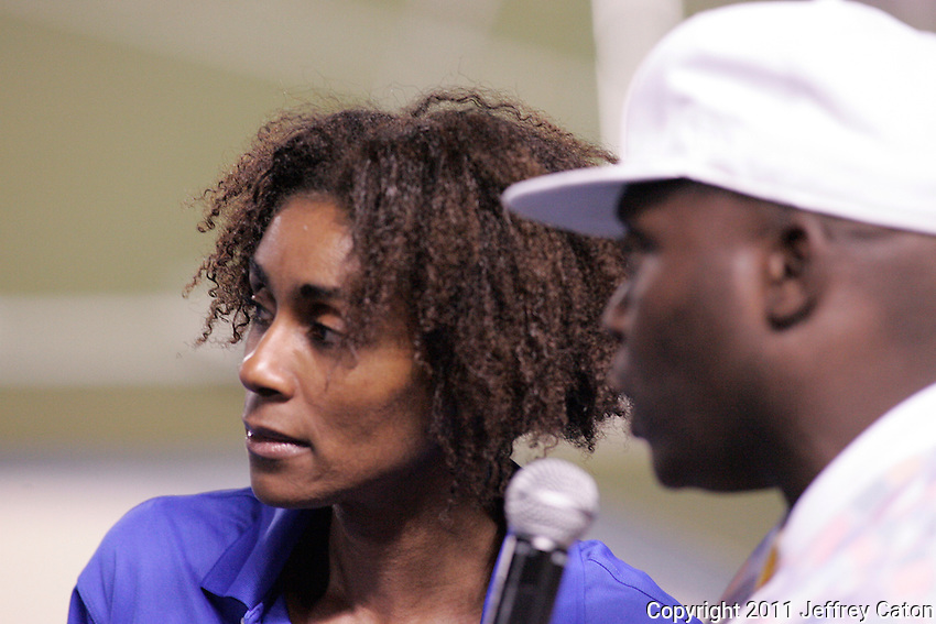 3-time Olympian Rosey Edeh interviews Musician Farley Flex at the Toronto International Track and Field Games held at the University of Toronto's Varsity Centre stadium, Wednesday July 13, 2011