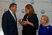 Lisa Friedman Clark, center, who's husband Andrew Friedman, was killed in the World Trade Center attack on September 11, 2001, speaks with former United States Secretary of Homeland Security Tom Ridge prior to speaking before 1300 women philanthropists at the Jewish Federations' 2016 International Lion of Judah Conference at the Washington Hilton Hotel on Sunday, September 11, 2016.  Looking on at right is former US Secretary of State Madeleine Albright.<br /> Credit: Ron Sachs / CNP