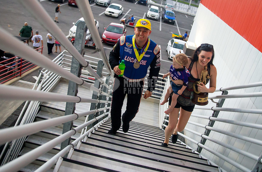 Jun 21, 2015; Bristol, TN, USA; NHRA top fuel driver Richie Crampton walks with his family up the stairs of the tower after winning the Thunder Valley Nationals at Bristol Dragway. Mandatory Credit: Mark J. Rebilas-