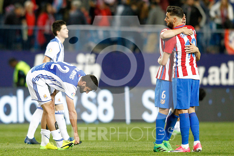 Atletico de Madrid's Koke Resurrecccion (l) and Yannick Ferreira Carrasco celebrate the victory in presence of Real Sociedad's Igor Zubeldia and Raul Navas during La Liga match. April 4,2017. (ALTERPHOTOS/Acero)