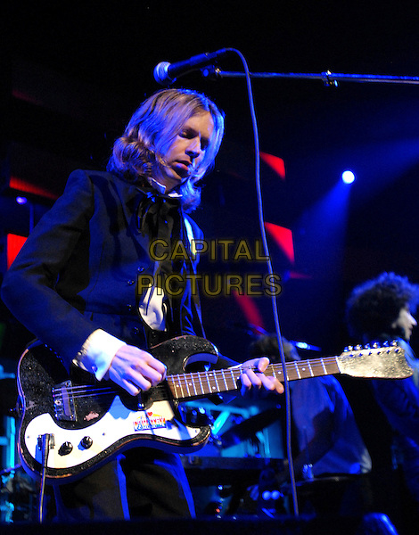 BECK.Live at Night one of The 106.7 KROQ Almost Acoustic Christmas held at The Gibson Ampitheatre in Universal City, California, USA. .December 10, 2006.stage concert gig performance music half length guitar.CAP/DVS.©Debbie VanStory/Capital Pictures