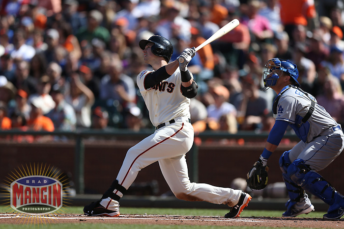 SAN FRANCISCO, CA - JULY 6:  Buster Posey #28 of the San Francisco Giants bats against the Los Angeles Dodgers during the game at AT&T Park on Saturday, July 6, 2013 in San Francisco, California. Photo by Brad Mangin