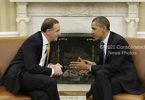 United States President Barack Obama (R) meets with Prime Minister John Key of New Zealand in the Oval Office of the White House in Washington, DC, Friday, July 22, 2011. .Credit: Yuri Gripas / Pool via CNP