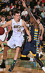 SPEARFISH, SD - FEBRUARY 6, 2016 -- Riley Ryan #32 of Black Hills State drives toward Kofi Josephs #4 of Ft. Lewis College during their college basketball game Saturday at the Donald E. Young Center in Spearfish, S.D.  (Photo by Dick Carlson/Inertia)