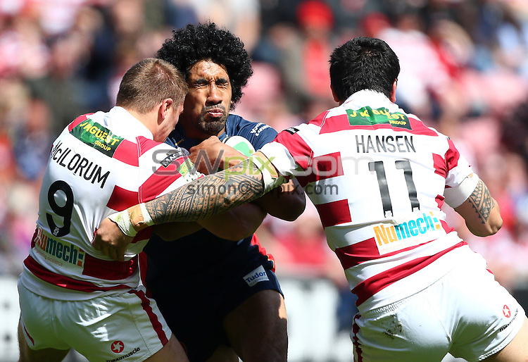 PICTURE BY VAUGHN RIDLEY/SWPIX.COM - Rugby League - Challenge Cup Quarter-Finals - Wigan Warriors v St Helens Saints - DW Stadium, Wigan, England - 12/05/12 - St Helens Sia Soliola is tackled by Wigan's Michael McIlorum and Harrison Hansen.