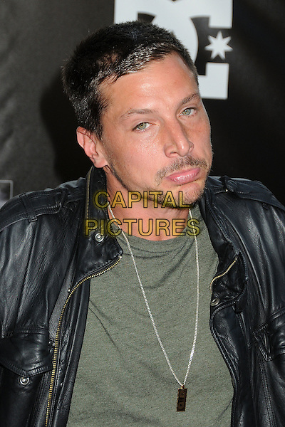 "Simon Rex, Dirt Nasty.""Waiting For Lightning"" Los Angeles Screening held at The Cinerama Dome, Hollywood, California, USA..April 10th, 2012.headshot portrait green top black leather jacket necklace  stubble facial hair funny .CAP/ADM/BP.©Byron Purvis/AdMedia/Capital Pictures."