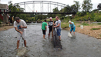 NWA Democrat-Gazette/FLIP PUTTHOFF <br /> Fish aficianados including Michael Gaines (from left) Johnathan Gaines, and Denny Rogers see what species the War Eagle River offers up Sept. 10 during a netting trip. The group enjoys netting darters and other small fish, identifying them and letting them go.