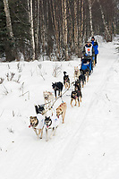 Harmony Barron w/Iditarider on Trail 2005 Iditarod Ceremonial Start near Campbell Airstrip Alaska SC