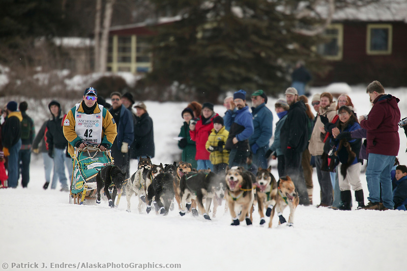 Dog Musher Ramy Brooks leaves the shoot for the 1000 mile 2003 Iditarod sled dog race from Fairbanks to Nome, Alaska . Lack of snow along the normal trail route further south forced the relocation of the restart on the Chena River in Fairbanks.