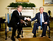 Washington, D.C. - September 29, 2008 -- United States President George W. Bush meets with Viktor Yushchenko, President of the Ukraine, in the Oval Office of the White House in Washington, D.C., U.S., Monday, September 29, 2008. <br /> Credit: Joshua Roberts - Pool via CNP