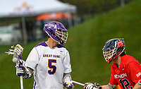 Connor Fields (#5) looks for an opening over Austin Cates (#12) UAlbany Men's Lacrosse defeats Richmond 18-9 on May 12 at Casey Stadium in the NCAA tournament first round.