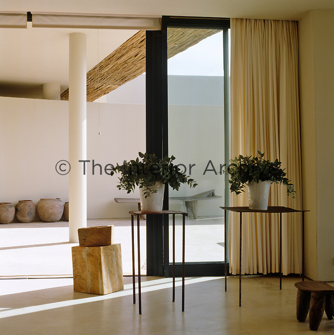 View through the sliding glazed doors of the living area to the terrace beyond