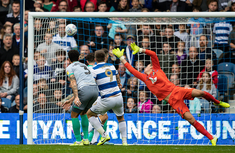 Blackburn Rovers' goalkeeper Christian Walton (right) is beaten by a header from Queens Park Rangers' Jordan Hugill (centre) to score his side's fourth goal <br /> <br /> Photographer Andrew Kearns/CameraSport<br /> <br /> The EFL Sky Bet Championship - Queens Park Rangers v Blackburn Rovers - Saturday 5th October 2019 - Loftus Road - London<br /> <br /> World Copyright © 2019 CameraSport. All rights reserved. 43 Linden Ave. Countesthorpe. Leicester. England. LE8 5PG - Tel: +44 (0) 116 277 4147 - admin@camerasport.com - www.camerasport.com