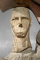 Close up of head of 9th century BC Giants of Mont'e Prama  Nuragic stone statue of a boxer, Mont'e Prama archaeological site, Cabras. 2014 excavation. Civico Museo Archeologico Giovanni Marongiu - Cabras, Sardinia. Art grey background