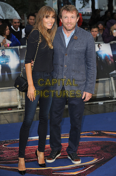 Jacqui Ainsley and Guy Ritchie<br /> 'Man Of Steel' UK film premiere, Empire cinema, Leicester Square, London, England.<br /> 12th June 2013<br /> full length black top jeans denim grey gray suit jacket beard facial hair couple <br /> CAP/BEL<br /> &copy;Tom Belcher/Capital Pictures