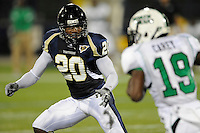 14 November 2009:  FIU cornerback O'Darris D'Haiti (20) defends in the first half as the FIU Golden Panthers defeated the North Texas Mean Green, 35-28, at FIU Stadium in Miami, Florida.