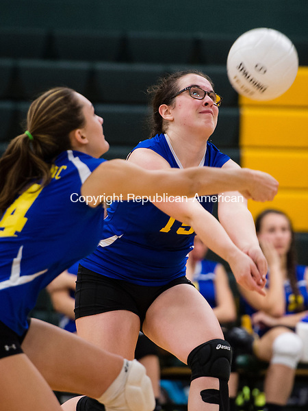 WATERBURY, CT- 27 October 2015-102715EC03-  Housatonic's Ashley Coon digs the ball with backup from teammate Brooke Dodge. Holy Cross swept the matches at home Tuesday night. Erin Covey Republican-American