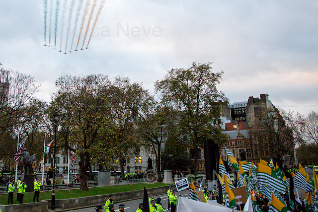 Red Arrows.<br /> <br /> London, 12/11/2015. Today, the Prime Minister of India Narendra Modi (Leader of the Bharatiya Janata Party, BJP; former Chief Minister of Gujarat from 2001 to 2014; actual Member of Parliament from Varanasi) met the British Prime Minister David Cameron at 10 Downing Street during his visit to the UK. After the meeting, the two Prime Ministers went to Parliament Square (cleared from traffic and members of the public) to pay tribute to the Mahatma Gandhi statue and to see the Red Arrows performing a flypast over Westminster. In the meantime, Sikh and Kashmir people protested patrolled by heavy police presence.