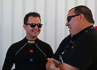 Sept. 21, 2013; Ennis, TX, USA: NHRA top fuel dragster driver Steve Torrence (left) talks to Elon Werner during the Fall Nationals at the Texas Motorplex. Mandatory Credit: Mark J. Rebilas-