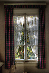 Hotel S in the Black Forest with window and tartan curtains