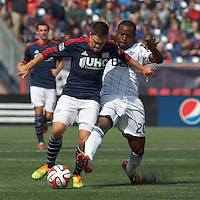 New England Revolution midfielder Kelyn Rowe (11) dribbles under pressure from Vancouver Whitecaps FC midfielder Nigel Reo-Coker (20). In a Major League Soccer (MLS) match, the New England Revolution (blue/white) tied Vancouver Whitecaps FC (white), 0-0, at Gillette Stadium on March 22, 2014.