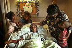 A dying mother, Priscilla Lipscomb lays in bed at Brookwood Gardens Convalescent Center in Homestead surrounded by her children and her mother. Left to right are, Tynisia McIntyre, 7, Lasaunda Lipscomb, 9, Pricilla's mother, Sue Lipscomb and Tyrell McIntyre, 6. Priscilla has cervical cancer.